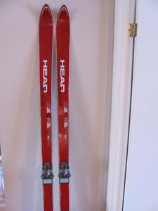 USED HEAD DOWNHILL SKIS ( RED )