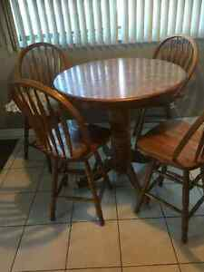 Small round table with 4 swivel 3 feet high chairs.