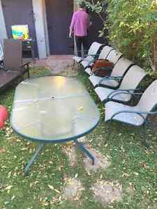 Glass top outdoor dining table & chairs