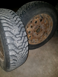 P185/65R14 Goodyear Nordic Winter tires with steel wheels.