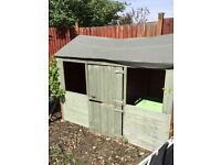 Wooden outdoor playhouse / wendy house