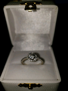 Engagement ring halo style with rose cut diamond.