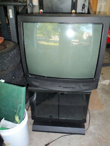 """27"""" GE 27gt530 CRT TV with black stand with glass doors"""