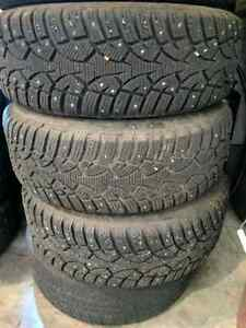 4 Bolt Studded Winter tires  $75 each no lower with rims