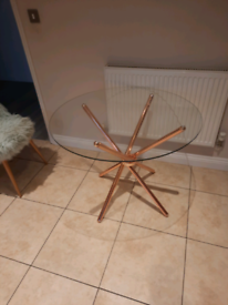 Glass table with rose gold legs