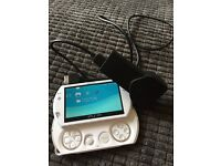 Psp go loaded with 1000,s of games