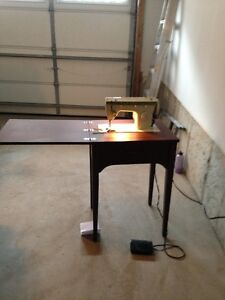 Vintage Singer sewing machine with console/table