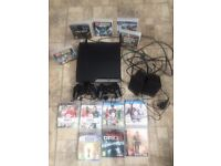 Sony PlayStation 3 with games two controllers and speakers