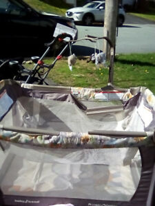 Travel cot with a accessories. Good condition.