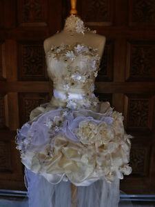 Vintage style wedding dress. One of a kind never been worn.