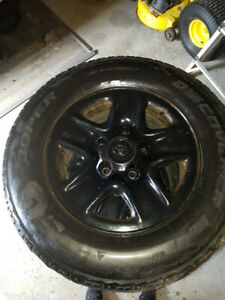 ***REDUCED*** Four Steel Tundra rims with centre caps and wheel