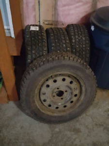 WinterTires with Studs & Rims 185/65 R14s used for 1yr