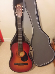El Dégas acoustic guitar with stand and hard case.