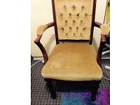 Antique carved arm chair in Newham