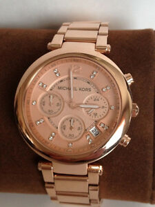 Mickeal kors watch is rose gold