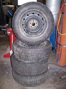4 BLIZZAK WS-80 WINTER TIRES ON STEEL WHEELS