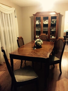 Dining room table, 4 cushioned chairs and buffet
