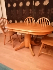 Pine table & 4, chairs, very good condition.