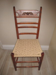 Hand crafted solid wood table with four chairs.