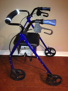 """Like new walker with large 8"""" wheels, padded seat, owners manual"""