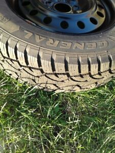 Dodge Grand Caravan Winter tires( Almost new,tires,rims,W.Cups )