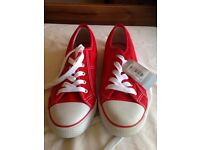Brand new red pumps with tags size 7