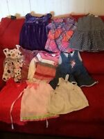 Box of size 2T baby girl clothes