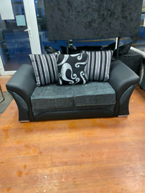 7. 3+2 seater grey and black suite