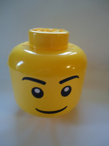 Large LEGO head for sorting and storing blocks.