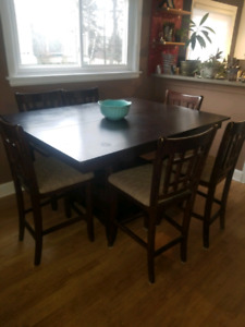 Pub style table with 6 chairs. Needs tlc