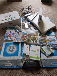 Wii Console and Accessories + Games