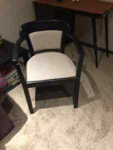 Painted black chair with neutral seating