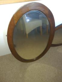 Antique wooden oval mirror pair