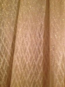 Reduce.4  tulle curtains $15 each