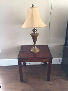 two coffee tables with two lamps