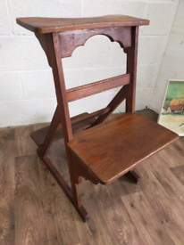 A Victorian Gothic revival prayer seat.