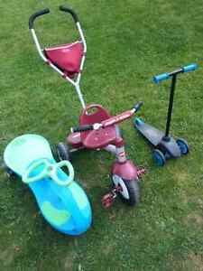 Plasma car, Radio Flyer push tricycle, Little Tikes scooter