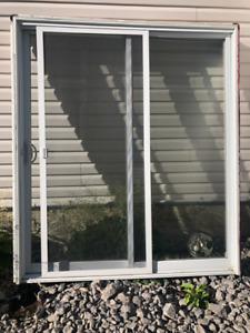 Sliding glass doors for sale. 13 years old but look new.