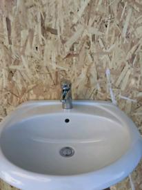 Bathroom sink tap and pedestol