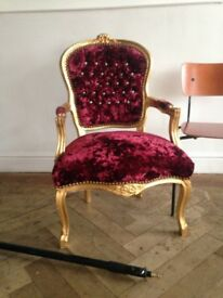 Velvet and gold arm chair great for beauty salon