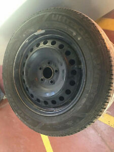 Good Year Ultragrip winter tires w/ rims 215/60/16 West Island Greater Montréal image 1