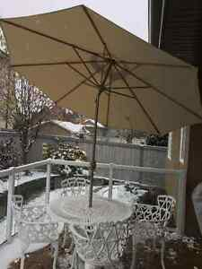 Quality Cast iron table & 4 chairs with umbrella