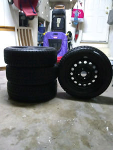 Pretty much new BRIDGESTONE BLIZZAK WINTER TIRES (195/65R15)