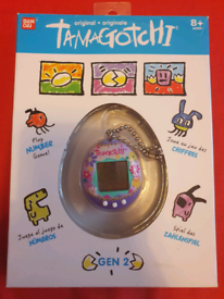 Tamagotchi original gen 2, purple paradise design.