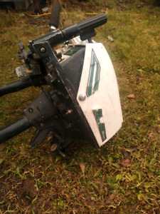 2 old Ted Williams outboard motors