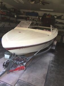 17' boat with trailer