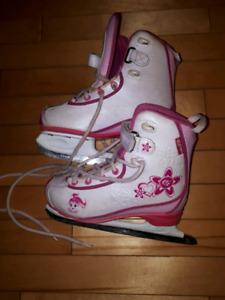 Girls size 13 CCM skates and helmet.