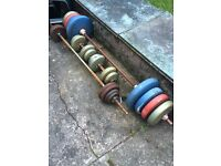Assorted weights and Dumbbells/barbells