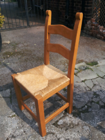 pair of chunky pine chairs with removable rattan seats (x2)