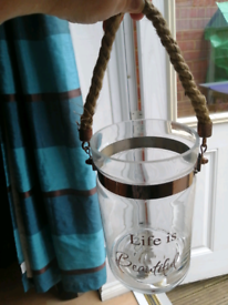 For sale a glass jar boat rope copper candle put in somethinkut